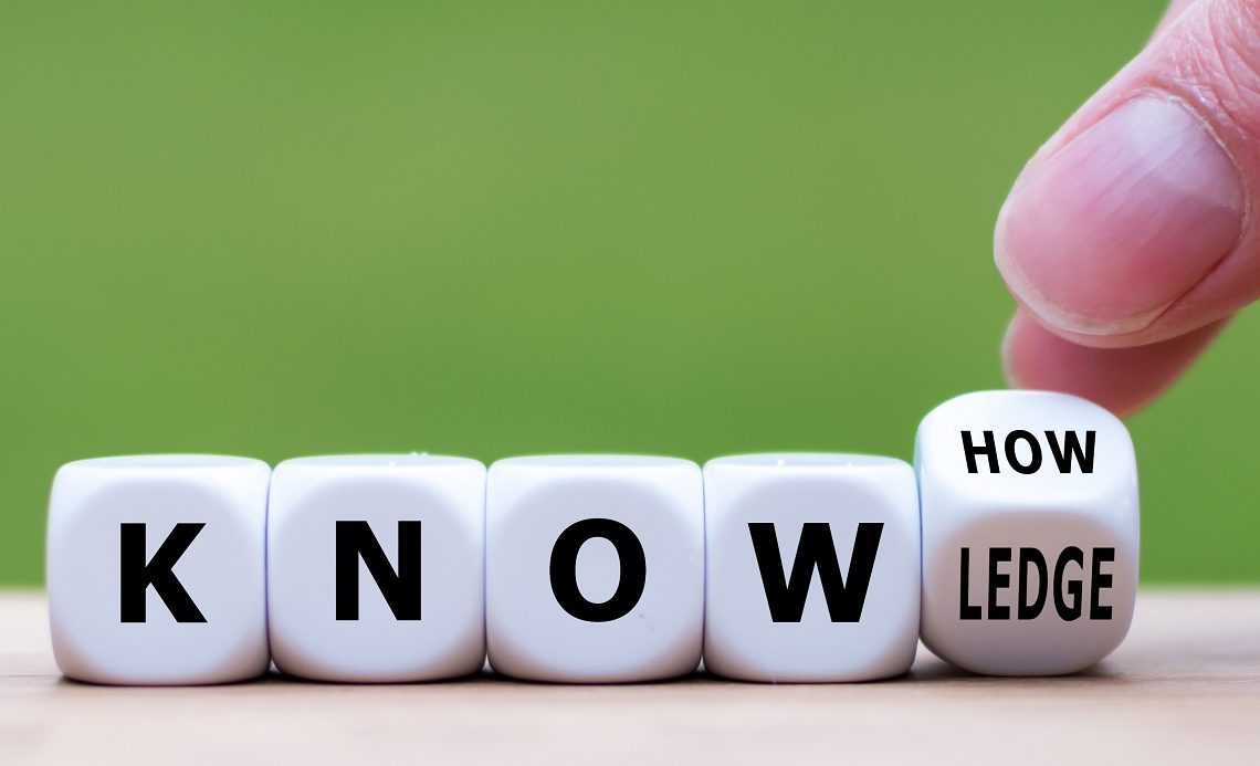 """To have know-how or to have knowledge. Hand turns a dice and changes the word  """"know-how"""" to """"knowledge""""."""